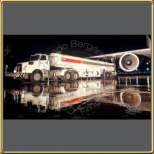 Exxon truck fueling airplane